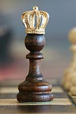A Golden Crowned Chess Piece Journal