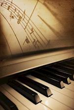 A Piano Keyboard and Sheet Music Journal